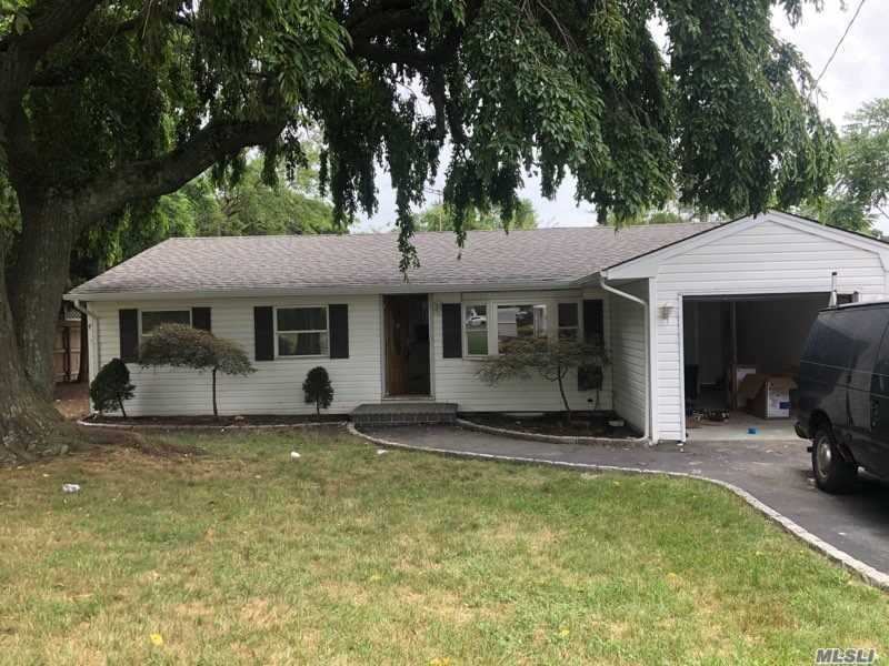 Beautiful Remodeled Ranch, New Kitchen With Granite Counter Tops W/ Back Splash & Stainless Steel Appliances, New Baths, Freshly Painted, 1 Car Attached Garage, Updated Floors And A Finished Basement, And Nearby Shopping Centers !!!