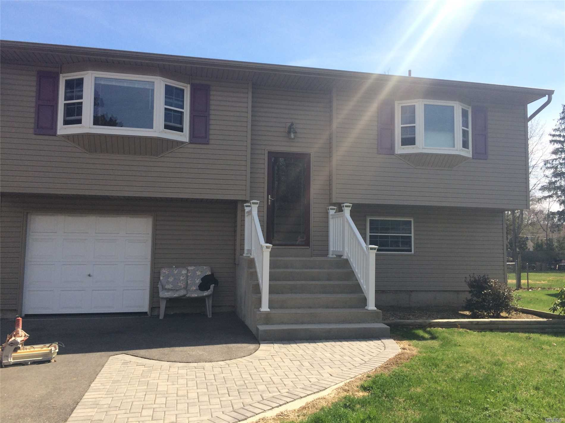 Great Hi-Ranch That Will Offer Brand New Kitchen, Young Bathrooms, Washer / Dryer, Large Rooms, Garage. Freshly Painted.