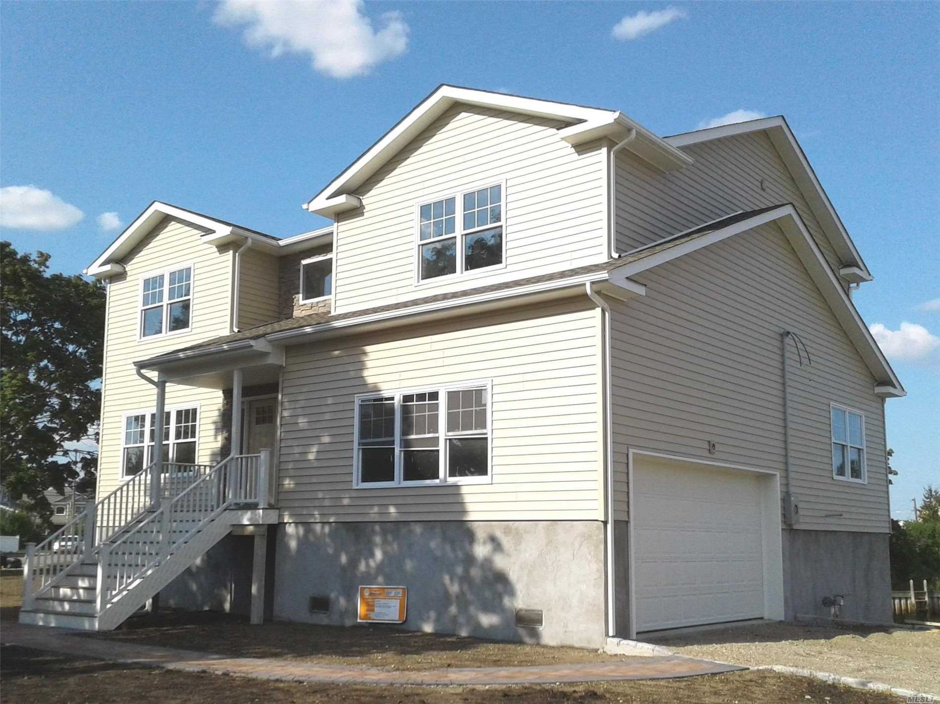 Gorgeous, Sprawling, Brand New Colonial In Seaford Sd #6. Build Is Fema Compliant So Low Flood Insurance(Approx Only $500.P/Year). No Expense Spared On This 3080 Sf, 4 Bedrm, 2.5 Bath Beauty With Waterview! Custom Wood Floors & So Much More To Fall In Love With!! Cac Of Course!! Mbr Has 2 Wic & A Classicly Designed En Suite, Full Bath With Double Sinks, Tub And Shower! Upstairs Laundry! Huge 2 Car Garage, Many Green Features!! Come See Asap!! (Buyer Pays Transfer Tax, Water/Sewer, Final Survey)