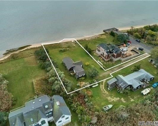 Beautiful Water Front W/Private Beach. Selling As Is On The Point Of Hart's Cove And Moriches Bay. Cottage Is Bulk-Headed, The Location Is Spectacular - Excellent Opportunity To Build New Or Renovate Existing. Priced To Sell. Don't Miss The Chance To Build Or Renovate Your Water Front Retreat With Private Beach.