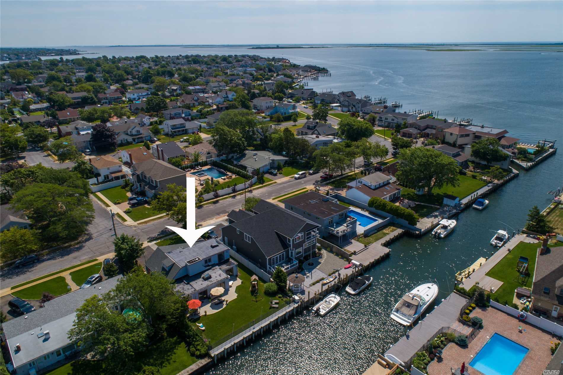 Vacation At Home! Enjoy Sunsets From Your First Floor Or Second Floor Master Bedrooms. Easy Access To The Bay. Open Floor Plan For Easy Living. New Navy Vinyl Bulkhead, Gas, Sprinkler Systems And Double Sided Fireplace.