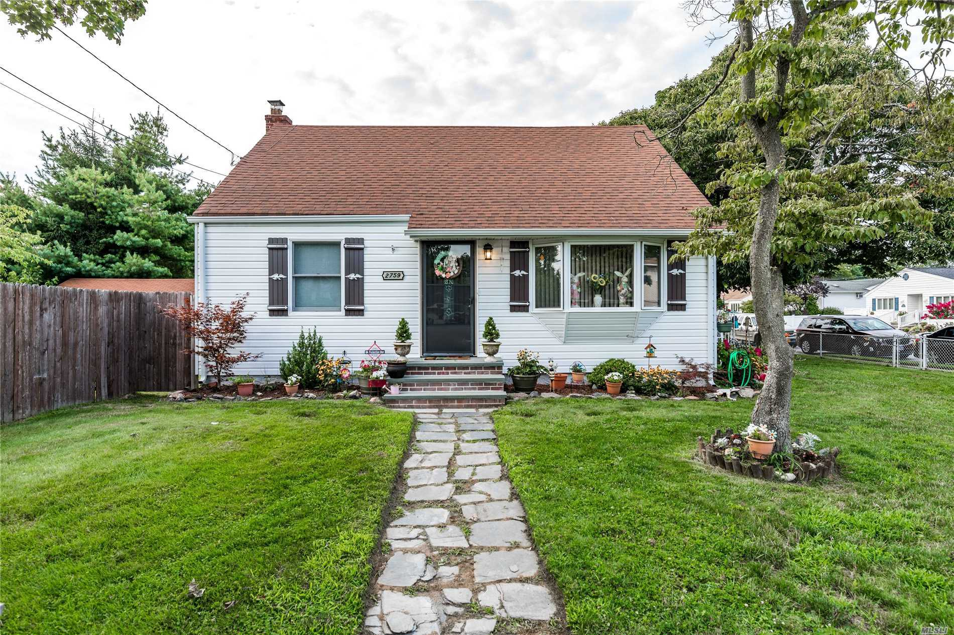 Great Corner Property With Many Updates. Great Family Space Off Kitchen With Access To Yard. New Dishwasher, Washing Machine And Hot Water Heater. Hardwood Floors Thru Out. Plumbing For 2nd Floor Bath In Walls.