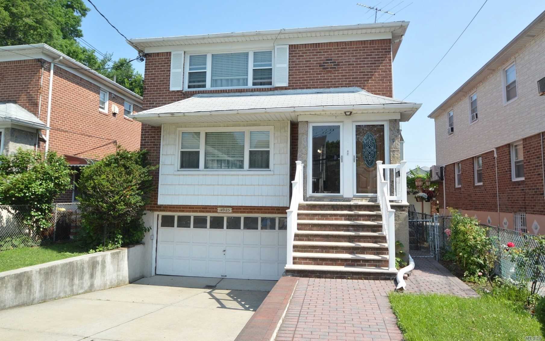 This Beautiful Brick 2 Family 3Full Beds Full Bath Mstr Suite Eik Lr Dr All Hardwoods...Large Backyard... Great Investment Property Or For Large Extended Families...