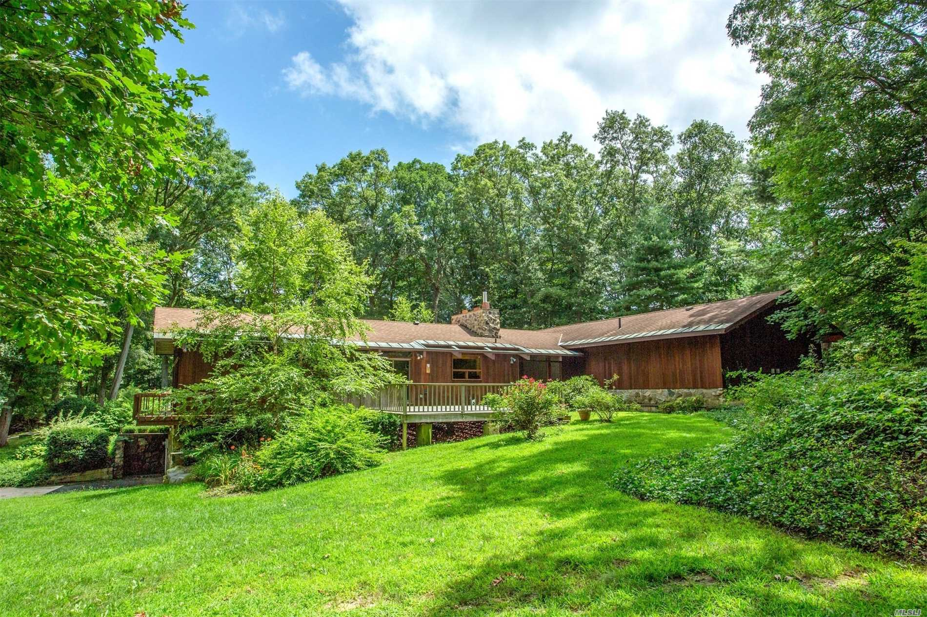 Aspen Style Resort Living On Long Island! Fall In Love With This Pastoral Setting Nestled On 2+ Country Acres With A 2 Stall Barn And Paddock, Adjacent To Miles Of Riding Trails. Offering An Open Floor Plan, Cathedral Ceilings And Spacious Rooms. This Horse Lover's Paradise Is The Perfect Retreat And The Perfect Place For Inspiration. Let The Love Affair Begin.