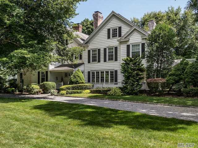 Old World Charm Abounds In This Stately 5 Bedroom Country Colonial. Completely Updated-New Heating And Air Conditioning- Two Mater Suite- Expansive Rooms- Richly Appointed Details. Almost Two Acres Of Beautiful Picturesque Landscaped Property. Salt Water Pool. Set On Cul-De-Sac Street. Wheatley Sd.