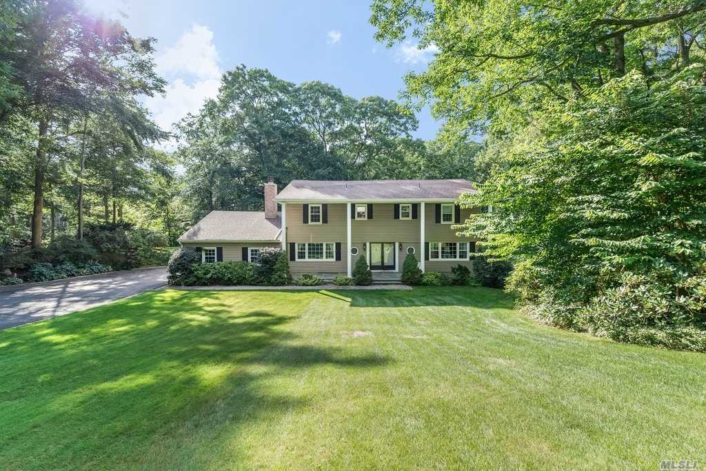 Traditional Center Hall Colonial Set Privately On 2 Acres At The End Of A Cul-De Sac And Backing The Fox Hollow Preserve. Beautifully Maintained With Wood Floors Throughout, Generous Entertaining Rooms, Fireplace In The Formal Dining Room, Den With Fireplace. Sun Room, Guest Bedroom & Full Bth Off Kitchen, Master Bdrm Suite W/Sitting Room Overlooking Lush Beautiful Property. 3 Large Bdrms W/Wood Flrs And Full Bth Double Sinks. Fully Finished Basement With Plenty Of Storage.