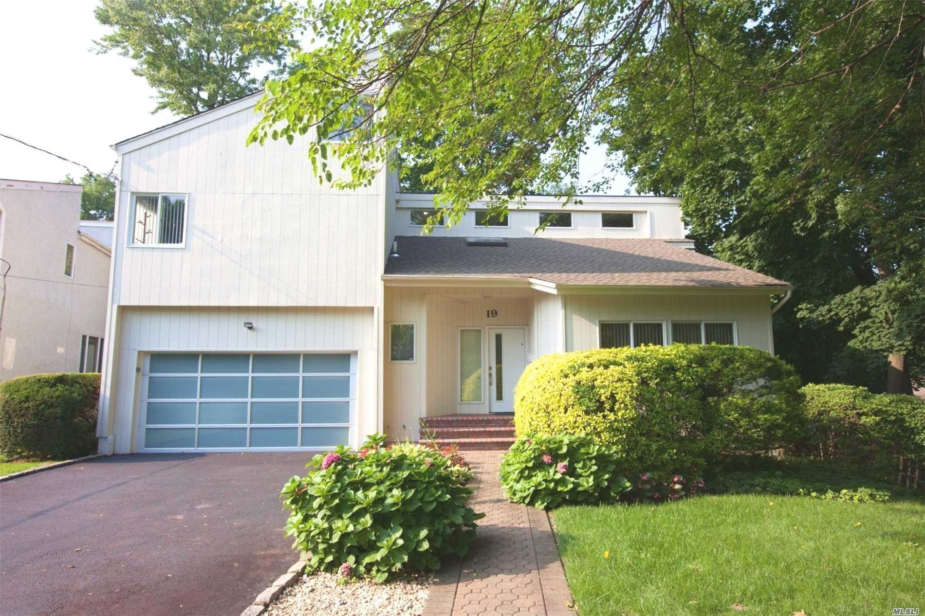 Southern Exposure To This One Of Kind Sun Drenched Contemporary 4 Bedroom Estate! Hard Wood Floors Throughout, Whole House Generator, New Custom Glass Garage Doors, New Cac Sys, Full Finished Basement, Cedar Closet, New Hot Water Heater, Anderson Windows, Central Vacuum, Brick Fireplace, Three Skylights, 3 Decks In The Backyard Over Looking A Pristine Creek. Port Washington Lirr 25 Mins To Nyc. Award Winning Great Neck Schools! (Baker Elem & North Middle High) Close To Village W/ Rests, Shopping