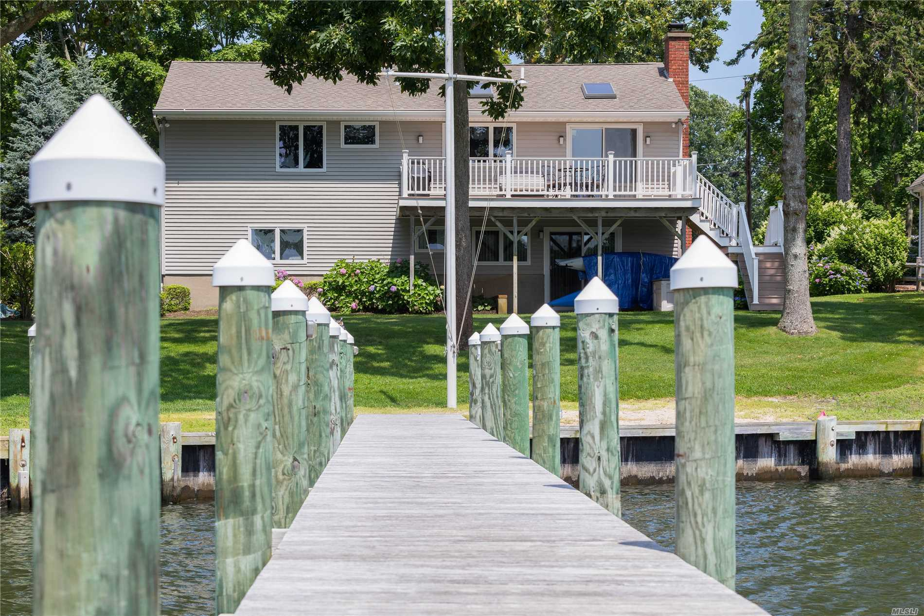 Dock With Access To Peconic Bay, Move In Ready With 3+ Bedrooms, 2 Full Baths, Open Floor Plan With Spacious Eat In Kitchen, Deck, 1 Car Garage, Walkout Lower Level, Located In The Heart Of The North Fork
