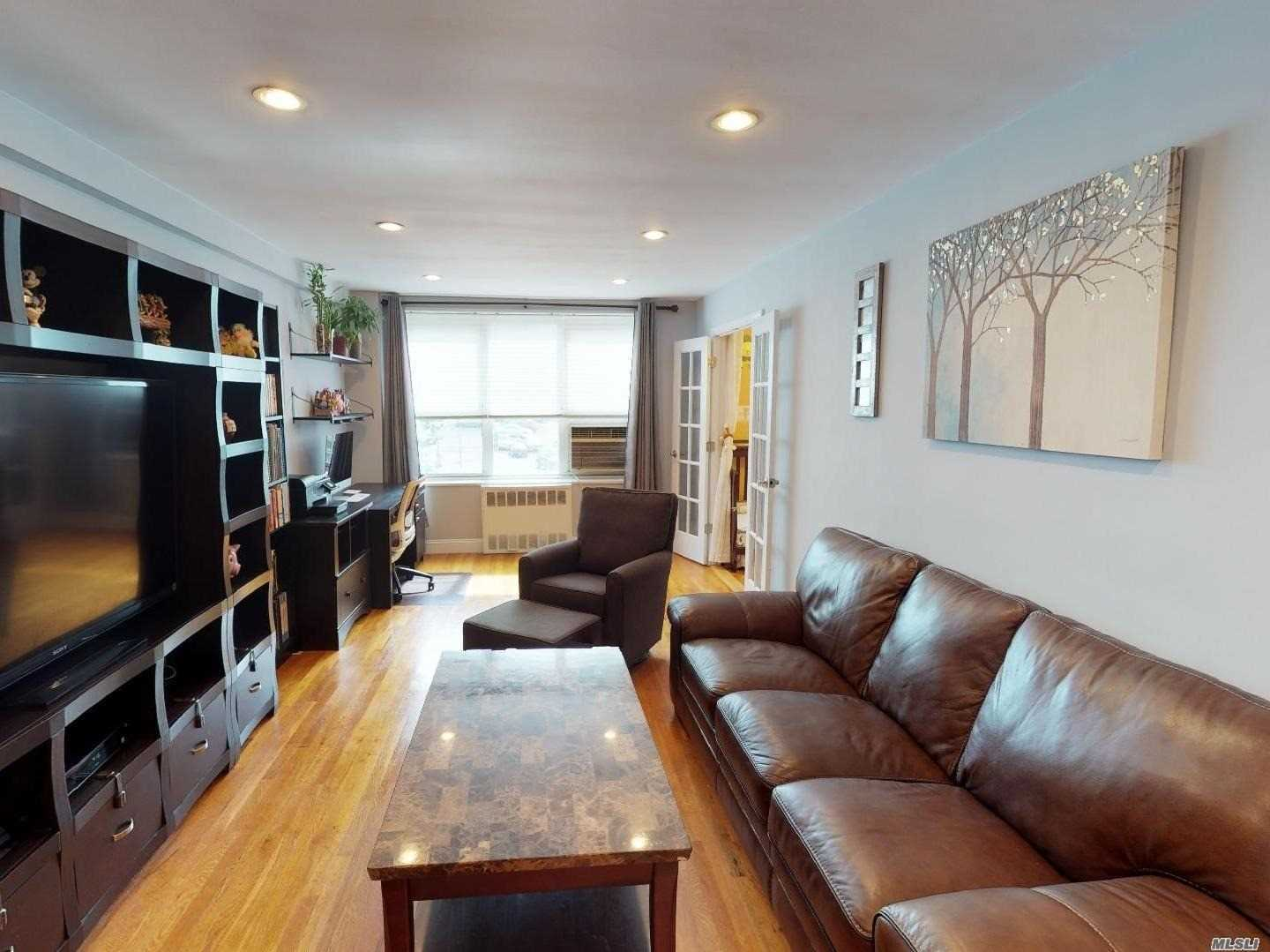 Beautiful Updated Junior 4 Apartment In Mint Condition Currently Being Used As A 2 Bedroom!(See Floor Plan), Recessed Lighting Throught. Low Maintenance And All Utilities Included!! Large Playground And Park Area. Near All: Transportation, Express Bus To Nyc, Q28 And Q13 To Flushing, Shopping, Supermarket, Close To Major Highways. Parking $60 Monthly, Extra Charge For Ac, Co-Op Owns Land. School District 26. Must See 3D Interactive Virtual Tour. Click Virtual Tour.
