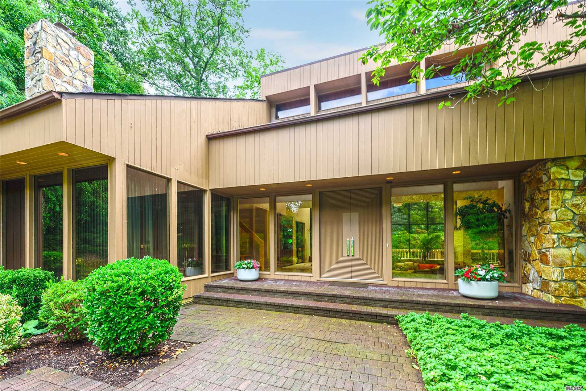 Secluded Estate On A Private Cul De Sac. A Must See Located On 2 Acres. Spacious Rooms, Plenty Of Closet & Storage Space, Skylights, Walls Of Windows. Many Rooms Walk Out To Deck Overlooking Country Club Style Pool Area. Lowest Level Walks Straight Out To Pool. Room For Tennis Court And More.