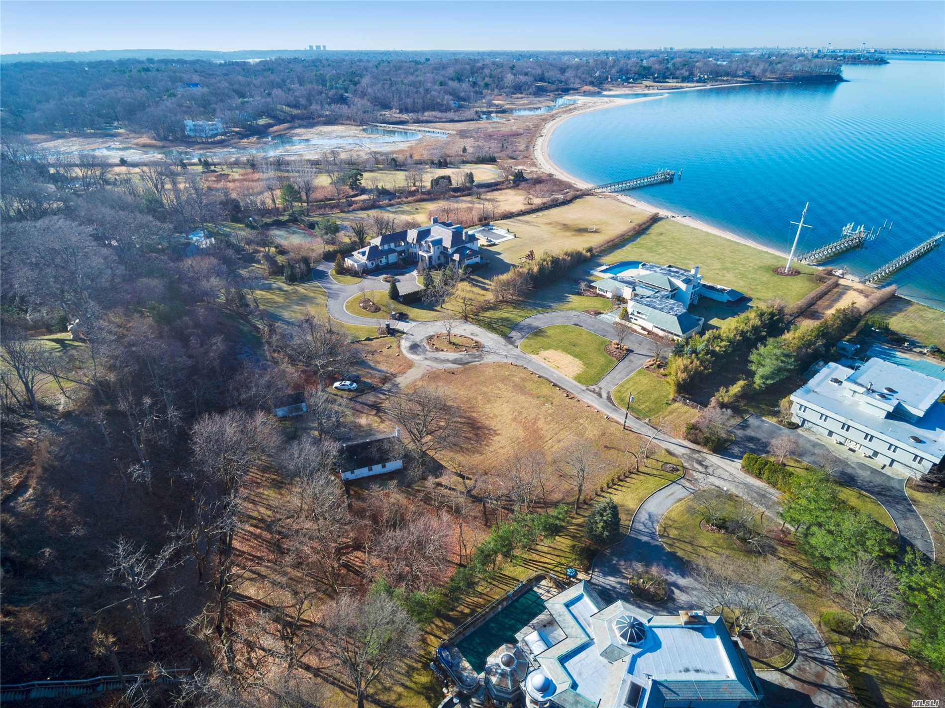 Cottage (Sold As Is) On 1.2 Acre Approved Building Lot In Prestigious Village Of Sands Point On A Quiet Private Street Lined By Multi-Million Dollar Homes. Unique Property Has The Opportunity To Obtain Spectacular Nyc Skyline, Water, Bridges, And Sunset Views. Includes A Permanent Easement To A Serene Mile Long Private Beach.