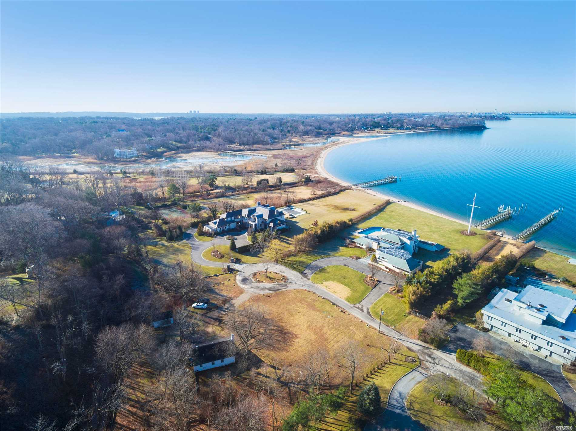 1.2 Acre Approved Building Lot In Prestigious Village Of Sands Point On A Quite Private Street Lined By Multi-Million Dollar Homes. Unique Property Has The Opportunity To Obtain Spectacular Nyc Skyline, Water, Spectacular Bridges, And Sunset Views. Includes A Permanent Easement To A Serene Mile Long Private Beach. Cottage On Property Sold As Is.