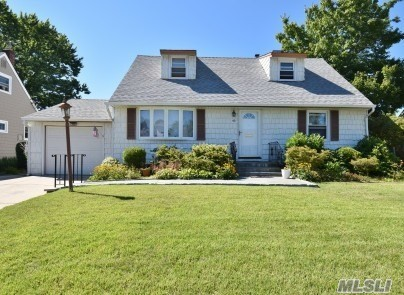 Lovely Well Maintained 4 Bedroom Cape With 2.5 Baths. Mid Block Location.Ductless A/C Units With Automatic Awning On Rear Deck. Over-Sized Property With Shed For Storage.