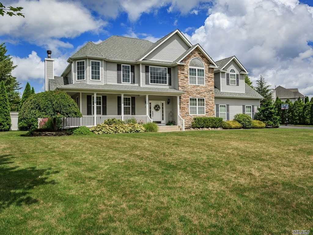 Best Value In Country Manors ! Come See This Beauty . The Spectacular Backyard Will Provide You With Years And Years Of Enjoyment . 2 Master Suites ( One On 1st Floor , 1 On 2nd Floor ) Fantastic Finished Basement With A Custom Bar , Huge Laundry Room And Tons Of Storage . 2 Car Garage And Extensive Landscaping .