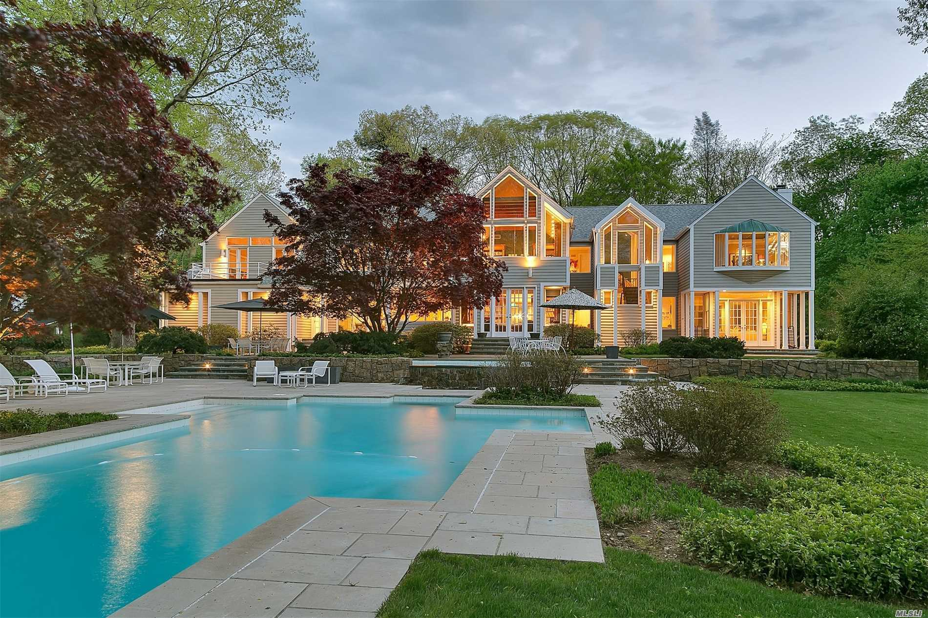 Dramatic Sun-Filled 6, 500 Sq.Ft. Contemporary With Long And Private Drive. Award Winning 11 Room, 5 Bedroom, 4.5 Bath Home With High Ceilings, Floor To Ceiling Windows, A Second Story Library, Custom Built-Ins Situated On 5 Pristine Acres Complete With A Four Car Garage, Pond, Dock, Pool And Waterfall.