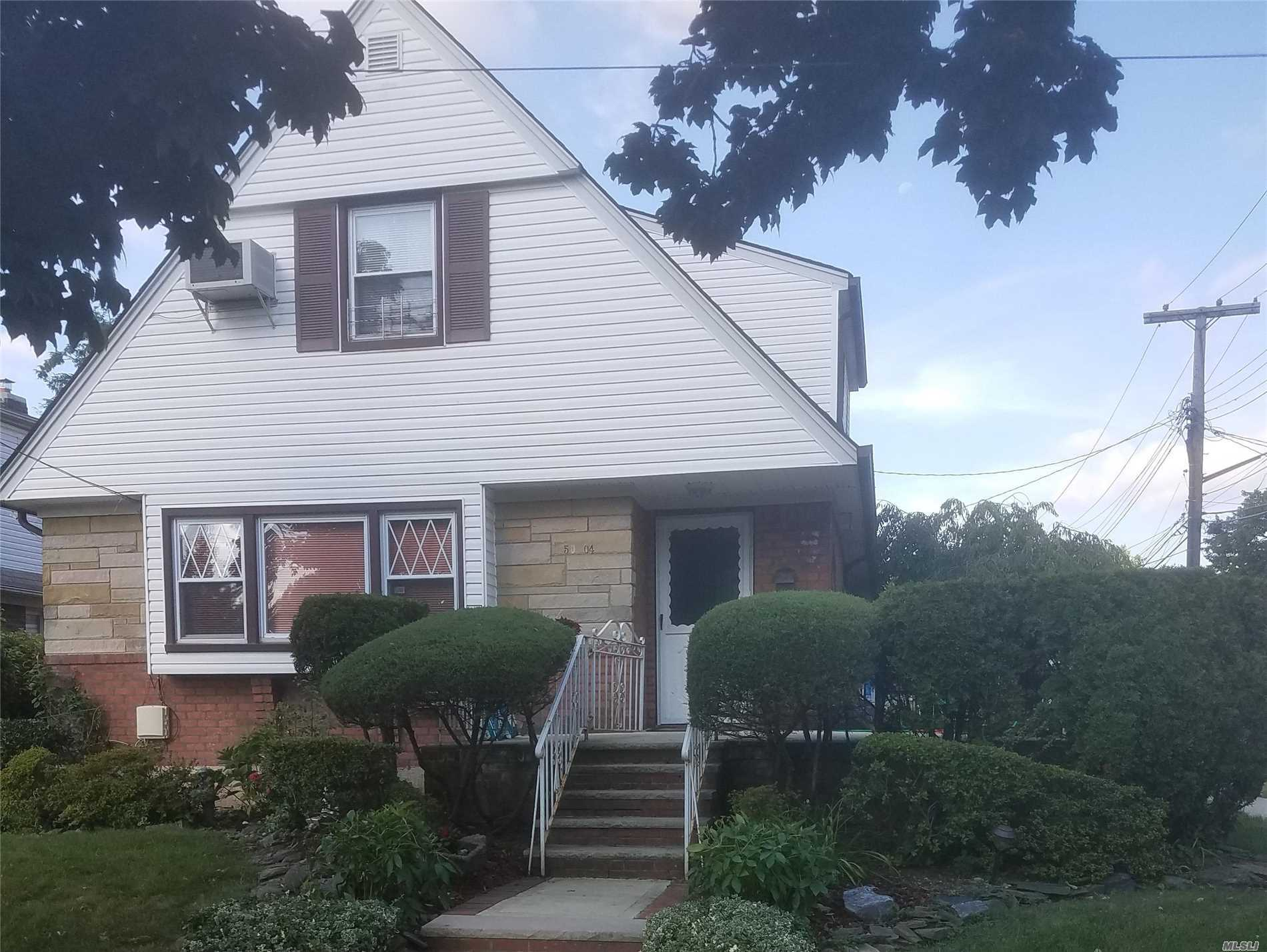 Spacious Cape On 50X100 Corner Lot In Desirable Bayside Hills. Well Maintained 4Br, 3Ba, Full Finished Basement W/Bar, Laundry Room And Separate Entrance. Second Floor Has Room For Mom W/Separate Living Area And Entrance. Large Deck Off 2nd Floor Bedroom. Lots Of Closet Space Throughout Including Walk-In-Closet. Sd#26. Convenient To Shopping, Schools, Public Transportation, Dining And Houses Of Worship.