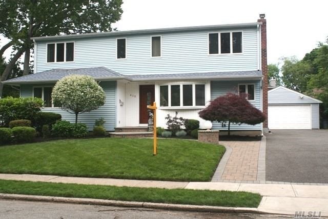 Beautiful 5 Bedroom, 3 Bath Colonial Situated Mid-Block On A Tree Lined Street. Finished Basement Has An Outside Entrance. Park Like Backyard With Paver Patio And Built In Fire Pit. Detached 2 Car Garage, In Ground Sprinklers,  2 Zone Central Air, Central Vacuum And Low Taxes. ***Please Note: Zillow's Description Of Schools Near By Is Incorrect. This House Is Barnum Woods Elem, Woodland Middle And East Meadow High School.