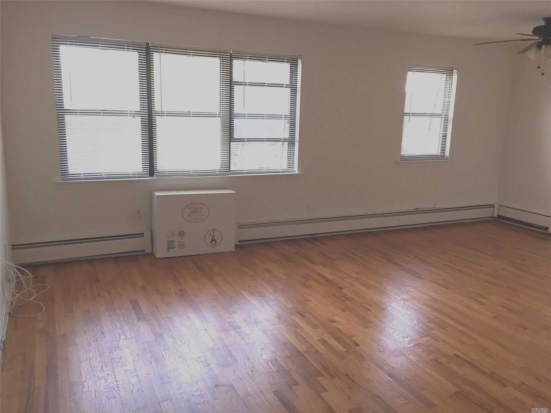 Clean, Spacious, Bright, 2 Family Condo, Wood Floors Throughout The Apartment, Close To Buses, Lie, Schools, Immediate Occupancy.