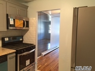 This Spacious 2 Bedrooms Is Brand New And Beautifully Renovated On 2nd Floor Of The 2-Family Condo House , Is In A Desirable Location With All New Bath, Kitchen, Granite Counter Tops And Stainless Steel Appliance. Hard Wood Floors Throughout. Close To All: To Mall, (Fairmarket) , To Lirr,  And Express Buses To Manhattan . Zone To Ps 221. Heat And Cooking Gas Are Included. One Parking Space Included. Don't Miss Out ! Won't Last!