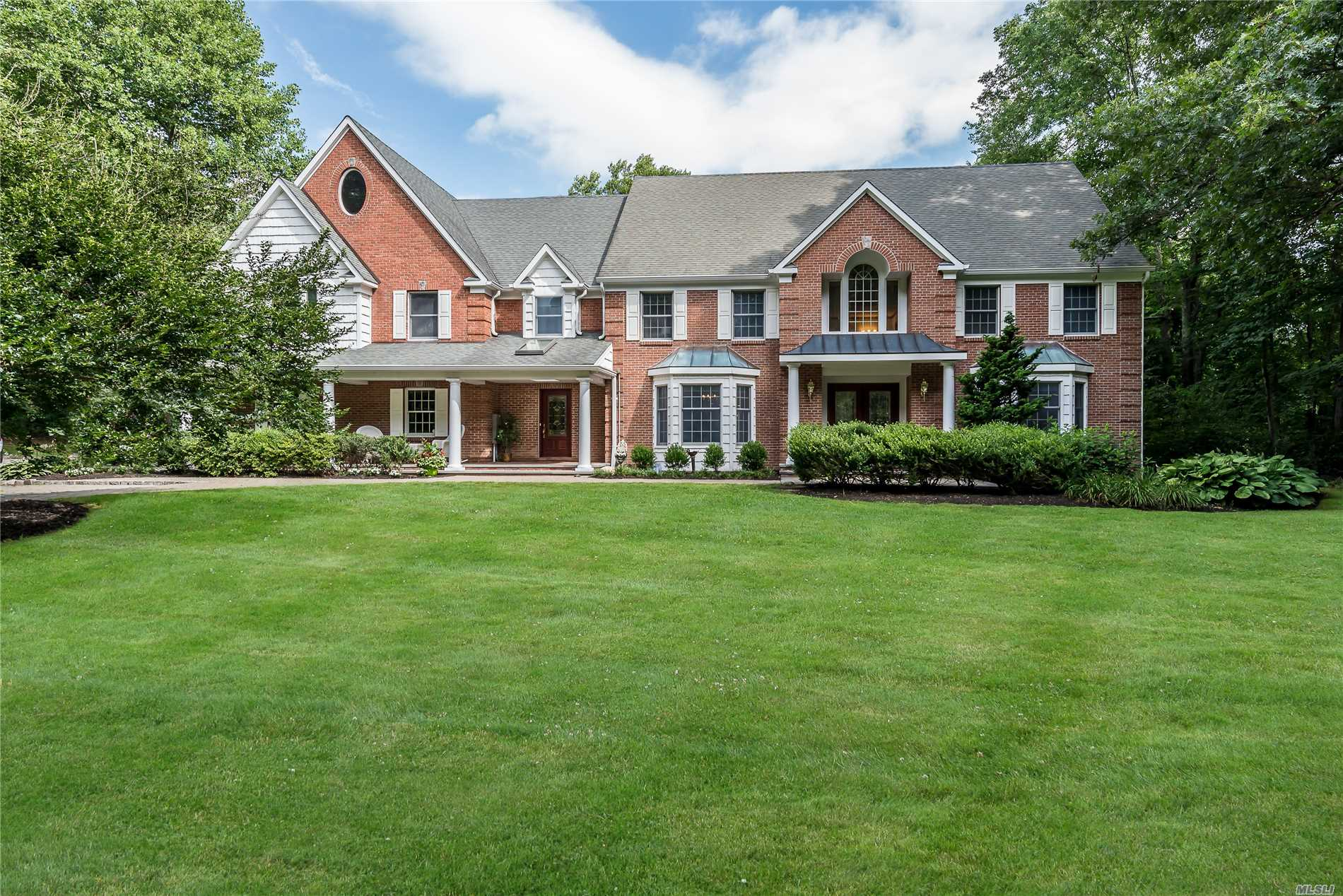 Spacious Custom Built Brick Colonial Nestled On 2.02 Flat Landscaped Acres On A Cul-De-Sac. 6 Bedrooms, 4.5 Baths. Expansive Eat-In Kitchen. Family Room With Fireplace. Office And/Or Bedroom Suite 1st Floor. In-Ground Pool With New Vinyl Liner. Horse Property. Fabulous Location.
