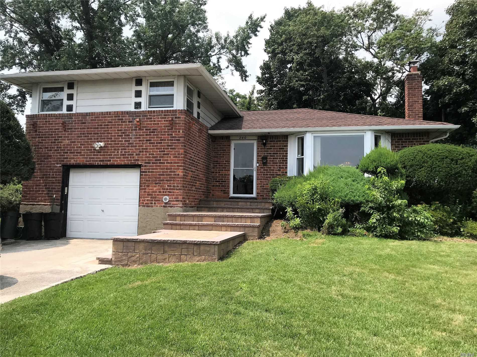 Split On A Cul Desac With East Meadow Schools #3 With Levittown Address, 4/5 Bedrooms, And 3 Full Baths, Central Ac, Hard Wood Floors, 5th Bedroom Could Be A Den Or Additional Master Bedroom. Large Deck, Very Private, Huge Basement