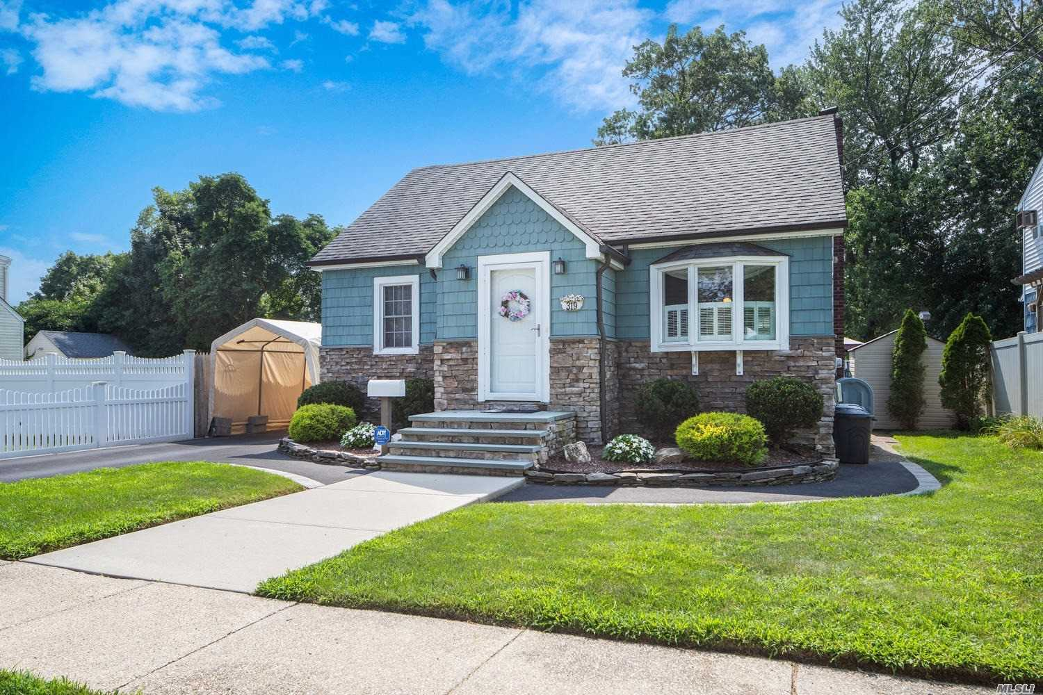 Spectacular Cape In The Village Of Lindenhurst. 1st Floor Features 2 Bedrooms, Full Updated Bath, Living Room, Dining Room And Kitchen With Granite Counters And S/S App Cooled With A Mini Split Ac. 2nd Floor Features 2 Bedrooms And A Full Bath. The Basement Is Clean, Bright And Has A Separate Outside Entrance. Perfectly Landscaped, New Driveway, 1.5 Car Garage And Super Low Taxes!