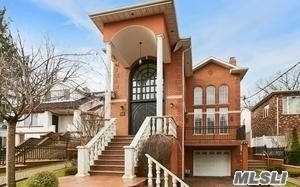 Spectacular Brick Colonial With Regal Columns, First Floor W/ Spacious Bright Living Rm, Large Dining Rm, Chefs Kitchen, Family Rm, Office, 1/2 Bath, Laundry Rm, & Guest Ste W/Full Bath. Second Floor: 2 Master Bd, Both W/ Walkin Closets & 1 Junior Suite W/Full Bath, & Additional Bedrm & Common Full Bath. Full Large Finished Basement. Additional: High Ceilings, Recessed Lighting Throughout, Gleaming Hardwood Flrs, 2 Fireplaces, 40 Solar Panels, Security Cameras, 1 Car Garage, Central Vacuum.