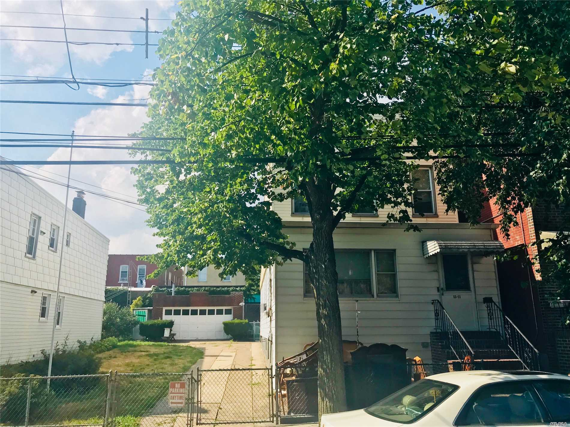 Existing Home Is A Large Two Family Home Approx 20?56 With 1766 Interior Square Feet. Home Features Identical Lay Outs Of 3 Bedrooms, Living Room, Dining Area, Kitchen And Full Bath. Full Basement With Working Washer And Dryer, Oil Tank And Half Bathroom. Basement Already Equipped With Separate Outside Entrance.  Adjacent Lot Is A Landscaped Garden Area With Driveway And Detached 2 Car Garage. Home Also Has A Concrete Back Patio Perfect For Enjoying Those Beautiful Queens Evenings.