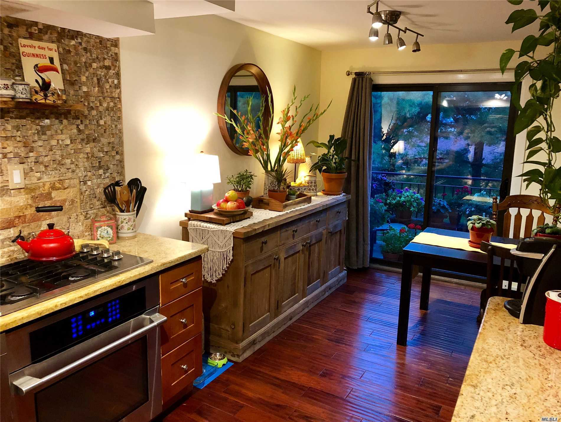 Bright And Sunny Renovated Condo Duplex With Terrace In The Beautiful Gated Community Of Beechhurst Shores. Three Bedroom, Two Bathrooms, Living Room, Formal Dining Room, Kitchen, Hardwood Floors. Pet Friendly. One Car Space. Special Assessment Of $ 175 Per Month For Complex Capital Improvements: Repaving And Pavers.