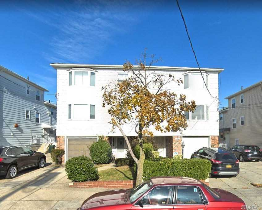 Very Spacious 4 Br Triplex Available For Rent In Bayside Features Living Room, Dining Room, Eat-In-Kitchen And 3 Full Baths. Hardwood Flooring Throughout. Includes Use Of W/D, 2 Parking Spots W/Garage + Back Deck. Close To All Transportation And Shops. In District 26, A Must See!
