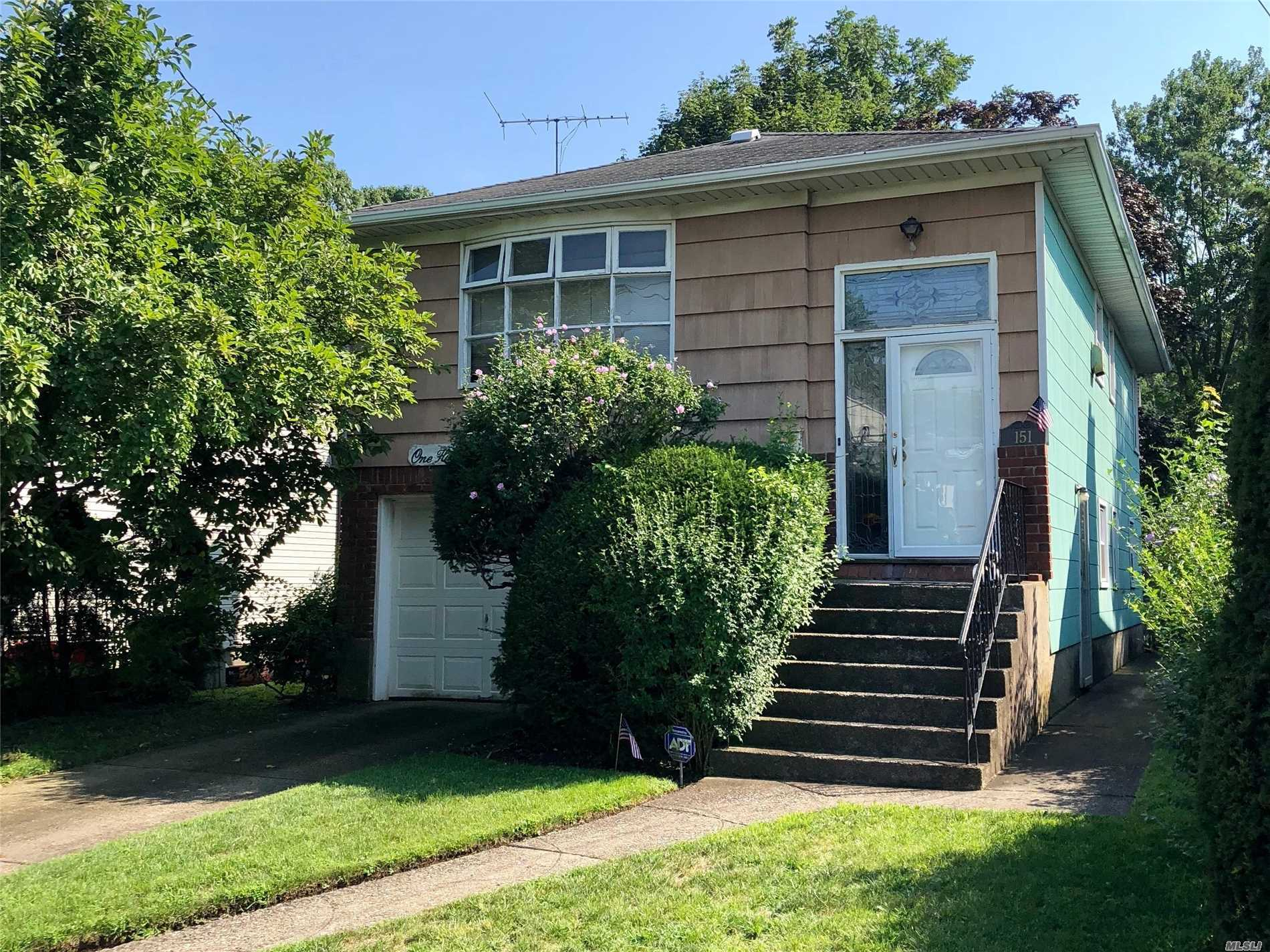 Living Room, Dining Area -Eat In Kitchen, Full Bath, Very Large Family Room, Down Stairs, Half-Bath, Laundry, Garage. Easy To Show ; Close To Parkway, Walking Distance To Lirr , Local Bus's, Quaint Village Area Of Malverne.