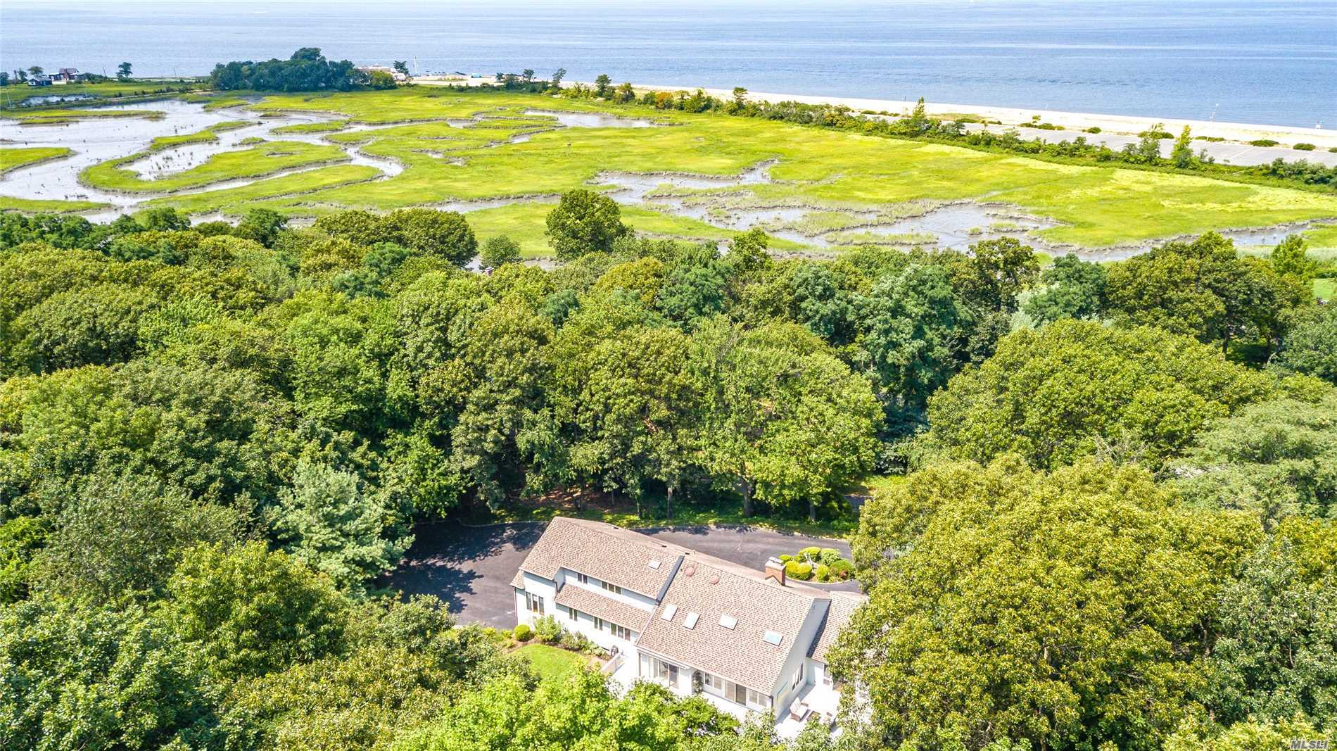 Enjoy Peace & Tranquility Of Lattingtown Living! Just 33Miles From Mid Town Manhattan.Lovely Views Of Long Island Sound, National Wildlife Preserve & Connecticut Shoreline. This Custom Built 4 Br 3.5 Bath Contemporary Farm Ranch Is Perched On A Knoll At The End Of A Private Cul De Sac. Set On 2 Acres On The Grounds Of The Former Stehli Estate.A Bright & Airy Floor Plan W/Vaulted Ceilings & Gourmet Center Island Kitchen Is Perfect For Entertaining! Generator. Cvac. Low Low Taxes!