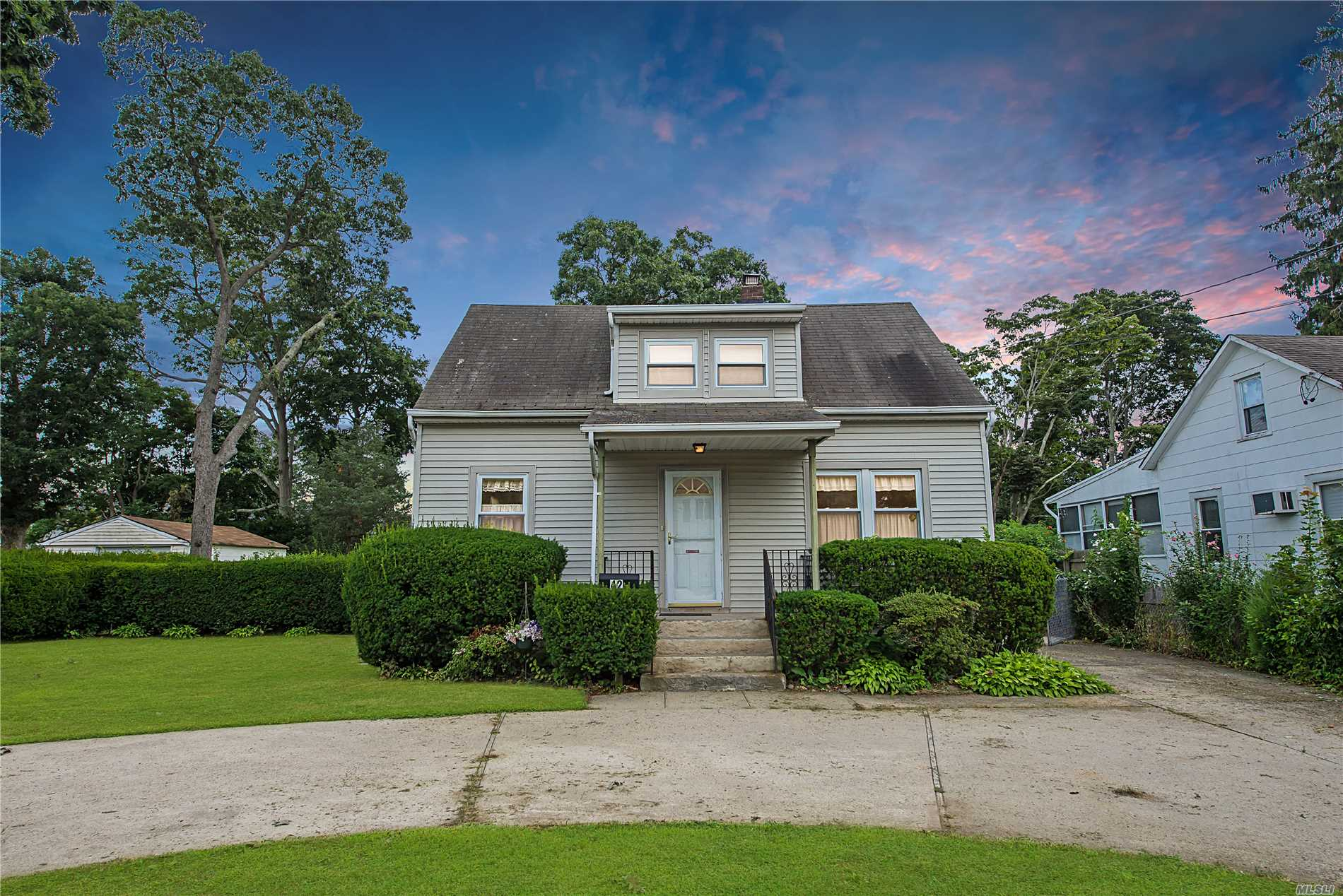 Expanded 3 Bedroom, 1 Bath Cape. Islip Schools! Large Dining Room Overlooks Landscaped Shy 1/4 Acre! 2 Large B/Rs On 2nd Floor - Along With A Common Sitting Area. H/W Floors Under Carpet. Extended Circular Driveway For Plenty Of Parking. Gas Cooking! Priced To Sell!