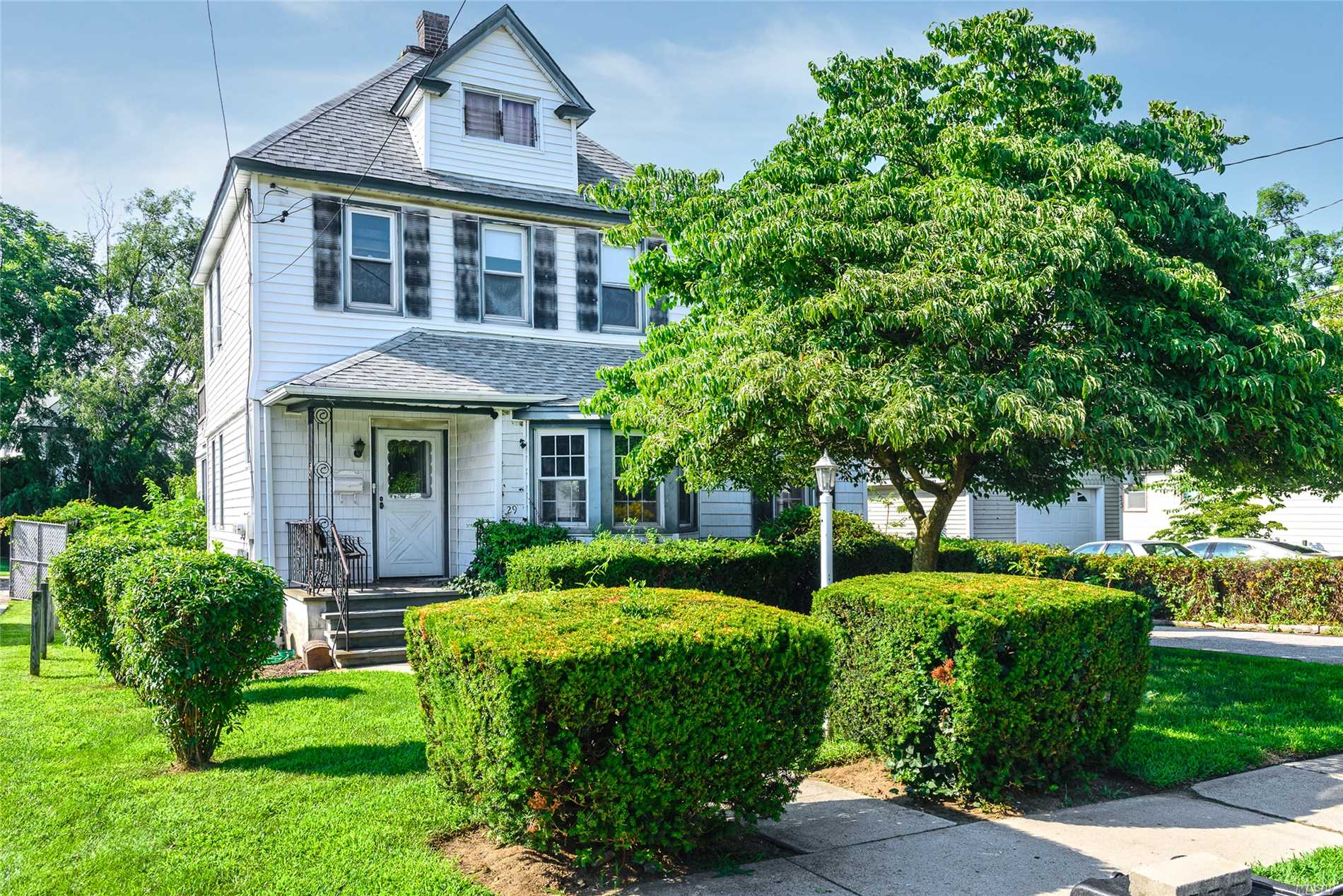 Legal 2-Family. 1st Flr: Entry Foyer, Spacious Living Rm, Formal Dining Rm, Eik, 2 Bdrms, Office, Bath, Laundry. 2nd Flr: Living Rm, Open Eik W/Island, 2 Bdrms, Bath & Walk-Up Attic W/Walk-In-Closet. Full Bsmnt, 2 Electric Panels, Cement Patio, Det Garage, Long Driveway, 170 Ft Deep Yard W/Fig & Chestnut Trees, Low Taxes & Convenient To Schools, Lirr, Shopping, Highways & Transportation. Needs Some Tlc - No Fha Loans Unless 203K Rehab Loan.
