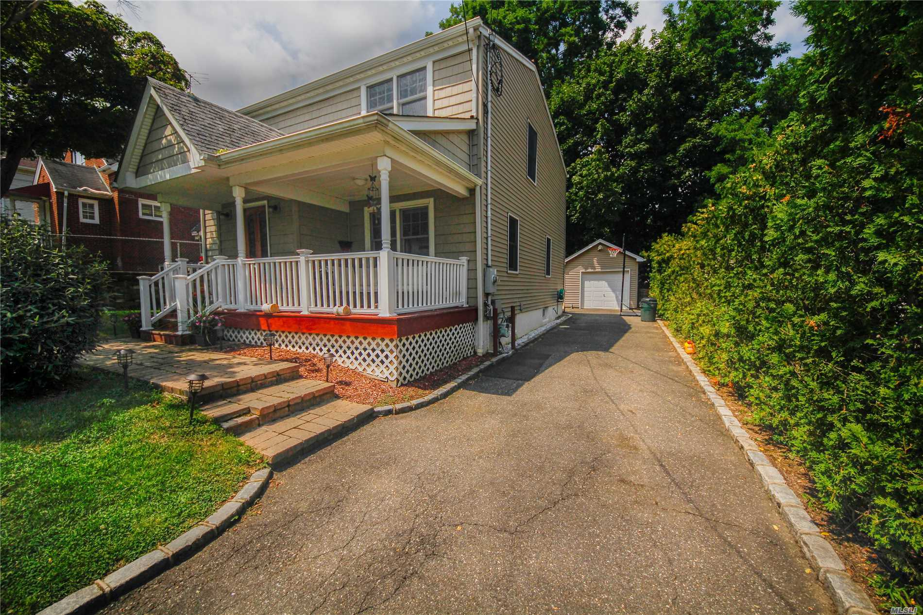 Remodeled Colonial In 2007 Featuring 3 Bedrooms And 2.5 Baths, Hardwood Floors, Open Floor Plan, Gas Heating, 1 Car Det Garage, Low Taxes & Full Finished Basement!