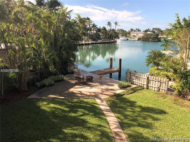 Large Waterfront, Corner Lot On Prestigious Harbor Drive. Expansive View Over Serene/Secluded Lagoon. Enjoy The Company Of Manatees And Dolphins In Your Backyard With A Sunset Backdrop. Direct Access To Beautiful Biscayne Bay With No Fixed Bridges. Recent Improvements To Property Include Refinished And Restored Original Terrazzo Floors, Completely Remodeled Kitchen With New Stainless Steel Appliances, Exterior And Interior Paint Job, New Landscaping, Renovated Dock With Brazilian Ipe Wood, Front Porch/Deck With Brazilian Ipe Wood. Build Your Dream Home, Add On Or Live In This Beach Cottage Style Home. Key Biscayne Was Recently Ranked The 'Best Place To Live' In The State Of Florida. Property Available And Easy To Show With 24Hr Notice. See Matterport Virtual Tour Link Attached.