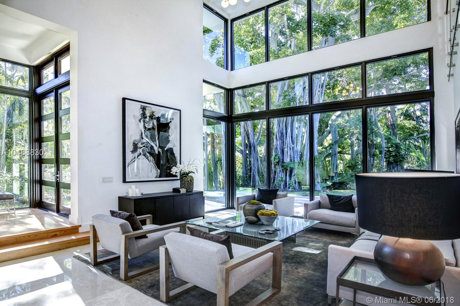 This Brand New Contemporary Masterpiece Is Located On A Tranquil Street Only Minutes From The Center Of Beautiful South Grove And The Shops Of Merrick Park. It Offers A Superb Floor Plan Comprising Six Bedrooms, Seven Full Bathrooms, And A Powder Room. The Property Conveys The Sensibility Of Being Outdoors, Due To Its Floor To Ceiling Windows Overlooking The Lush Landscape Of Coconut Grove. The Interior Space Was Meticulously Designed And Luxuriously Appointed With Marble And Solid Wood Floors. Nowhere Else Can One Experience A Lifestyle Such As This.