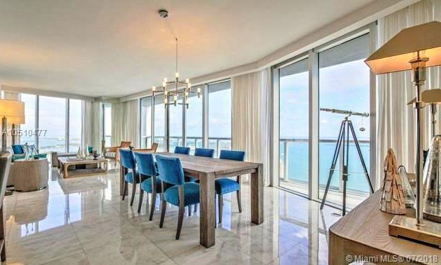 Best Ph Listed At Icon Brickell. Most Sought After 01 Line. Unit Comes Fully Upgraded With Marble Floors And Italian Wood Panels On Walls Creating A Sophisticated And Modern Feel. Impressive Views With 180 Degrees Of Biscayne Bay And Ocean. This 3 Bedrooms 2 Baths +1/2 Has An Ideal Distribution And Comfortable Floor Plan. This Corner Unit Offers Privacy And Quietness While Still Being In The Heart Of The Financial District. A Must See!!
