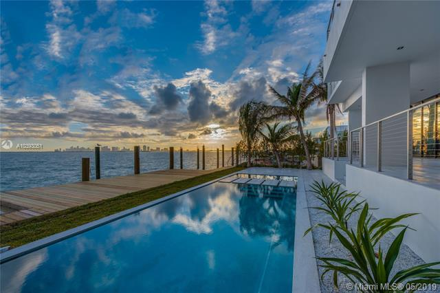 New Modern Masterpiece Offering 60-Ft Of Bayfront & Unobstructed Views Of The Miami Skyline! Situated On A 9, 000-Sf Lot, This 6-Beds 6+1-Baths Home Welcomes You With A Beautiful Courtyard Leading To A Glass-Enclosed Entry Foyer With Dramatic Double-Height Floor-To-Ceilings Glass. The Open Concept Floor Plan, Wall-To-Wall Glass Doors, & 10-Ft Ceilings Thru-Out Allow For The Maximum Exposure Of Magnificent Water Views Everywhere. Finishes Include: Mia Cucina Kitchen, Subzero & Wolf Appliances, Wood Floors, Floating Stairway, Italian Doors. Five Beds Up, Including Bayfront Master With Sitting Area, Huge Terrace, Walk-In Closet, & Luxe Bath. Backyard With Heated Pool, Spa, Huge Covered Patio, & Summer Kitchen. New Seawall & Dock, 2-Car Garage, & 2-Car Carport. Built In 2018 By On One Group.