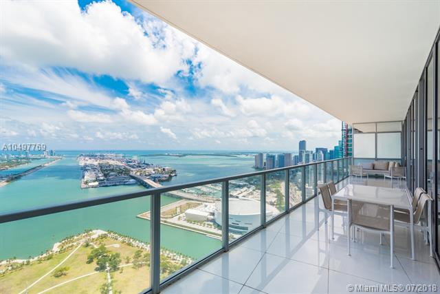 One Of A Kind Combo Unit At Marquis Miami. This Designer Finished 4 Bds/4.5 Ba 03/04 Combo Has One Of The Most Spectacular Views In The Entire City. This Sky Home Has 2, 975 Sq.Ft. Of Interior Space And Has One Of The Largest Terraces In The Building. Finished With White Glass Floors Throughout Including Showers And Baths, White Lacquer Cabinets In Kitchen And Baths, Upgraded Lighting Throughout This Unit, Over Sized Laundry Room With 2 Washers And 2 Dryers, Built Ins And More. This Unit Is Perfect For Entertaining With A Total Of 4 Elevators That Open In Right Into The Unit. Marquis Has Sunrise Lap Pool And Afternoon Pool And A Stunning Pool Deck And Full Gym. Unit Has 2 Deeded Parking Spaces And More.
