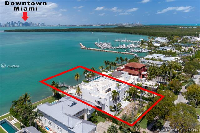 Enjoy Unobstructed Views Of Downtown Miami & Biscayne Bay From Tropical Key Biscayne. Situated On The Best Street On The Island, The 3-Story Modern Home Was Built Strong With 2 Floors Of Beautifully Finished Living Space Plus Ground Floor With 5-Car Garage, Staff Room, & Generous Storage Space. Finished With Marble Floors, The Living Areas Consist Of Formal Entry Foyer, Entertainment Bar, Living Room, Family Room, Eat-In Kitchen With Breakfast Area, Formal Dining, & Office. Two Beds On The First Floor, 4 Beds Including Master On The Second. Other Features Include: Walnut Floors & Doors, Marble Baths, Access To Roof Top, Utility Room. Master Bed With Private Terrace, 4 Closets, & Marble Bath. Outside, Expansive Pool Deck, Large Pool, Spa, Dock. Experience Island Living Like-No-Other.