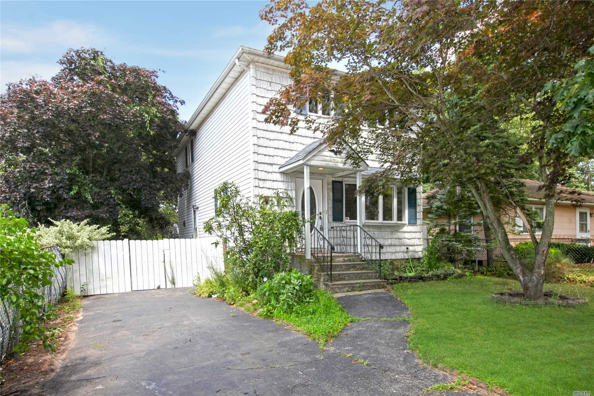 Great Opportunity To Own A Home In Patchogue For Such A Low Price. This 3 Bedroom 1 Full Bath Colonial Offers A New Kitchen With A Tiled Back-Splash & Granite With New Appliances, Newly Finished Oak Flooring Throughout, Freshly Painted Including The Basement. Home Located On A Dead End Street. Don't Miss Out On This Great Opportunity.