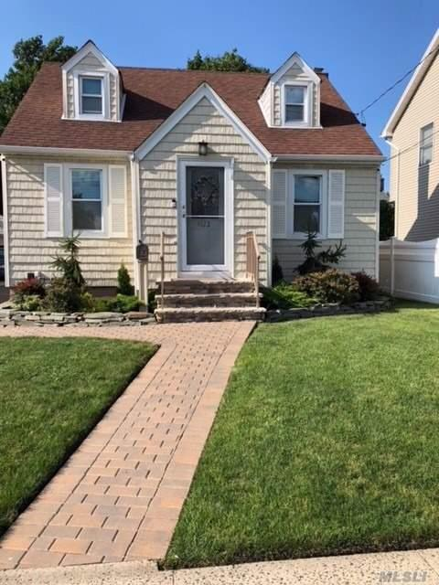 Beautiful, Cozy, Clean & Updated! This Cape Features 3Br's, 2Fb's, Living Room, Kitchen W/Granite Counters, Stainless Steel Appliances, Cherry Wood Cabinets, H/Wood Flrs, Lg Full Finished Basement W/Ose, Gas, Igs, 150 Amps, W/D. All New Patio, Pvc Fence, Stoop & Landscaping. Extras Inc Custom Blinds, Alarm, Camera System & The Ring Db All Connected Thru Wifi. Polk St Elementary & H. Frank Carey Hs. Be The First...Not The Last!