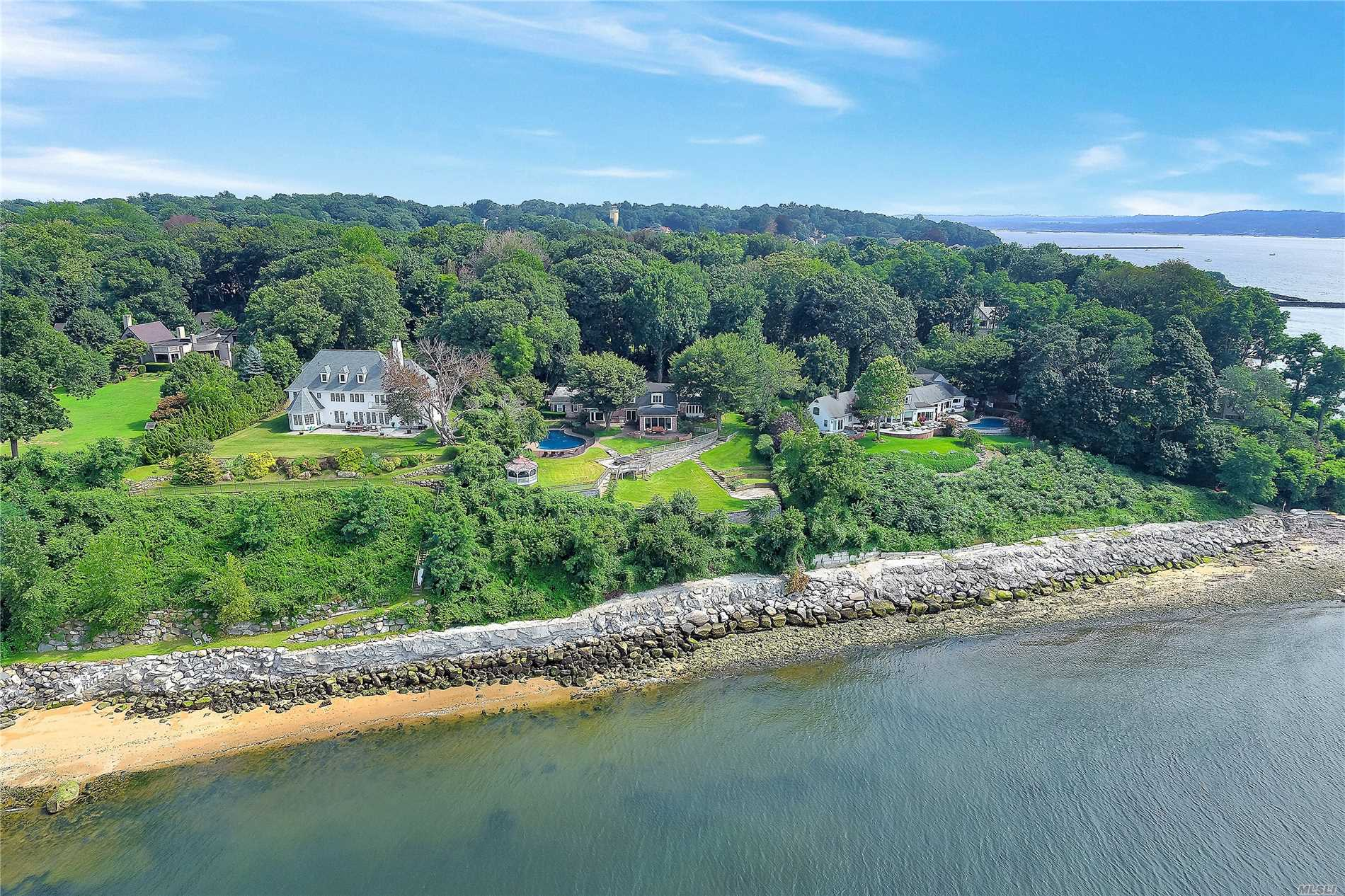 Glen Cove. Incredible Waterfront Getaway Situated On Over An Acre Of Land (Property Includes 0.34 Acre Adjacent Lot), This Serene & Quiet Colonial Is Breathtaking. Featuring Sun Room With Beautiful Vistas Of The Sound, Living Room With Fireplace, Amazing Cooks Kitchen With Breakfast Area And Glass Doors To Back Patio, Master Suite On The Main With Sauna, & Guest Wing. Unimaginable Backyard For Entertaining, With Patio, In-Ground Pool, & Remarkable Water Views.