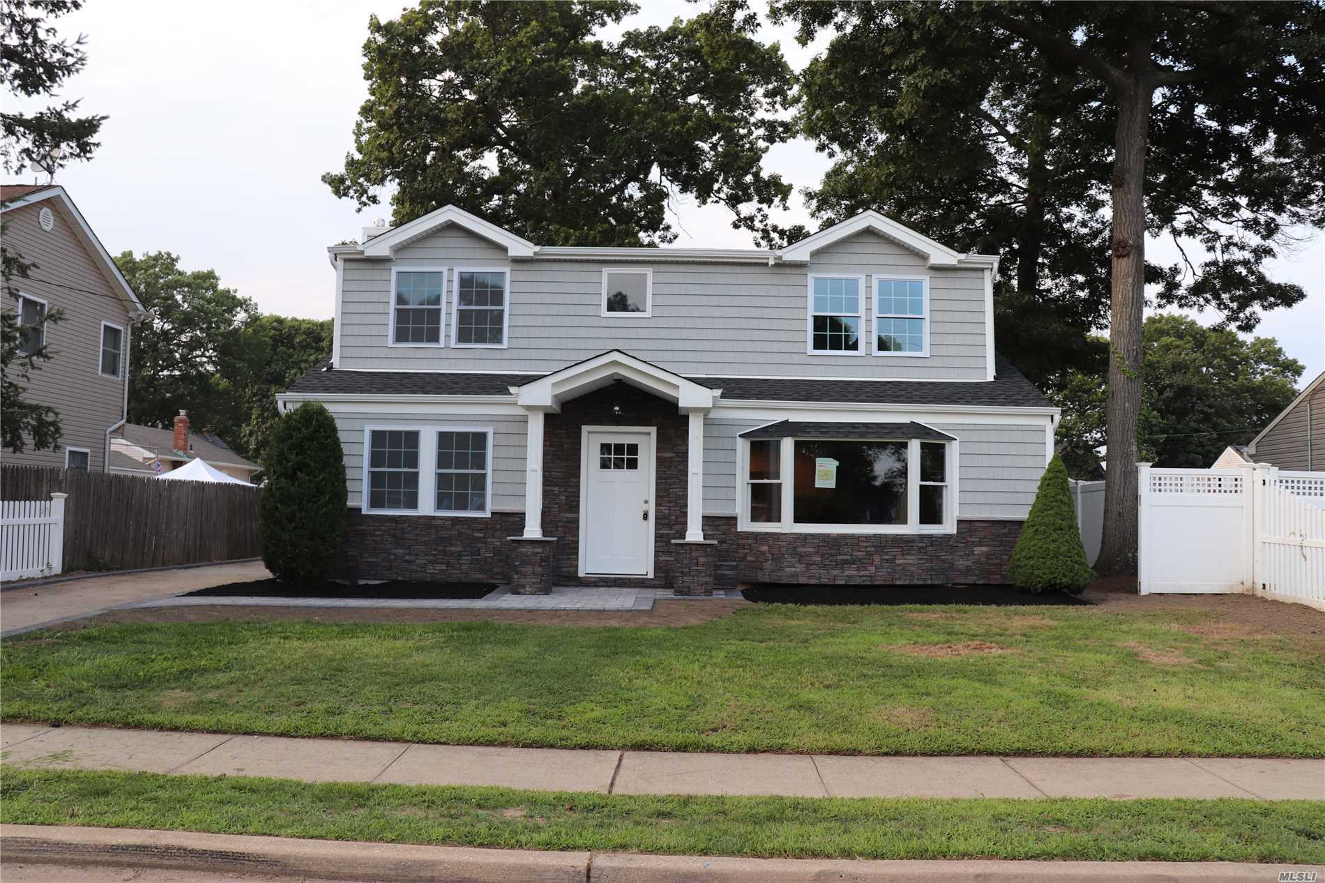 Custom Renovated Colonial In The Heart Of Massapequa Park. This Home Features Large Open Floor Plan , Eik, Formal Dinning Rm, Living Rm. Family Rm/5th Bedroom, Master Ensuite, 3 Add'l Bedrooms , 3 Full Baths. Completely Gutted And Renovated All Permits Filed , Anderson Windows , New Roof , New Siding , Cac . Much Much More , Walk To Railroad & Town . Wont Last Must See !!!!!!Note Still Not 100% Finished , Driveway And More To Be Done