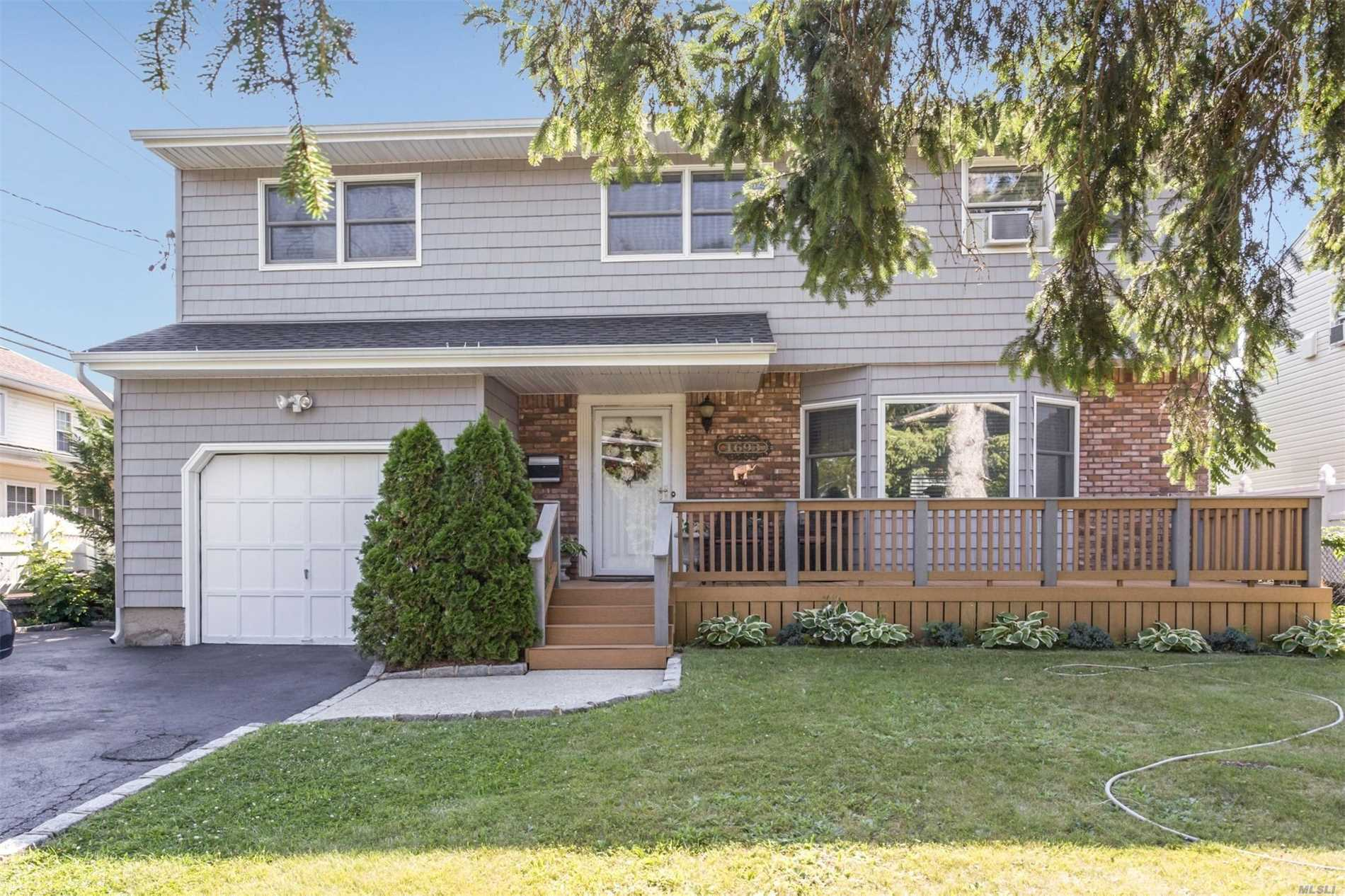 This Gorgeous Colonial In Wantagh Woods Features- New Large Eat In Kitchen , New Bathrooms, 4 Bedrooms , Master Bedroom (19'7 X 12') With A New Master Bath - Other Bedroom Dimensions-(16'3X12'3) (12'2X12') ( 13'8X 10'10) - Large Formal Dining Room -Large Den Family Room - Formal Living Room With Fireplace, Finished Basement -New Roof, Siding -Hardwood Floors Throughout, Over Sized Property- 1.5 Car Garage. Solar Panels -