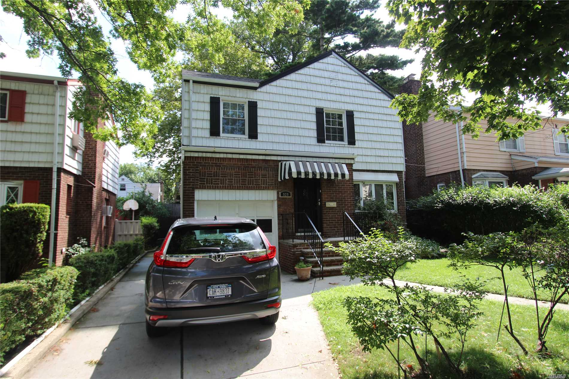 Detached 4 Bedroom - 2.5 Bath Colonial Style One Family Home In The College Estates Section. First Floor Features A Living Room W / Fireplace, Dining Room, Kitchen, Half Bath And A Handicap Accessible Bedroom With Full Bath. The Second Floor Has 3 Bedrooms And Bathroom W/ Jacuzzi Tub. There Is A Full Basement And A One Car Garage. Move-In Condition.
