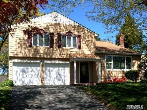 Large And Updated Splanch Home. Home Offers Eat In Kitchen W/Ss Appl, Formal Dining, Den W/ Fireplace, Living Room W/ Vaulted Ceilings, Master Suite W/ Full Bath, And 3 Additional Large Bedrooms. Entertainers Yard With Ig Pool. Smithtown Schools.