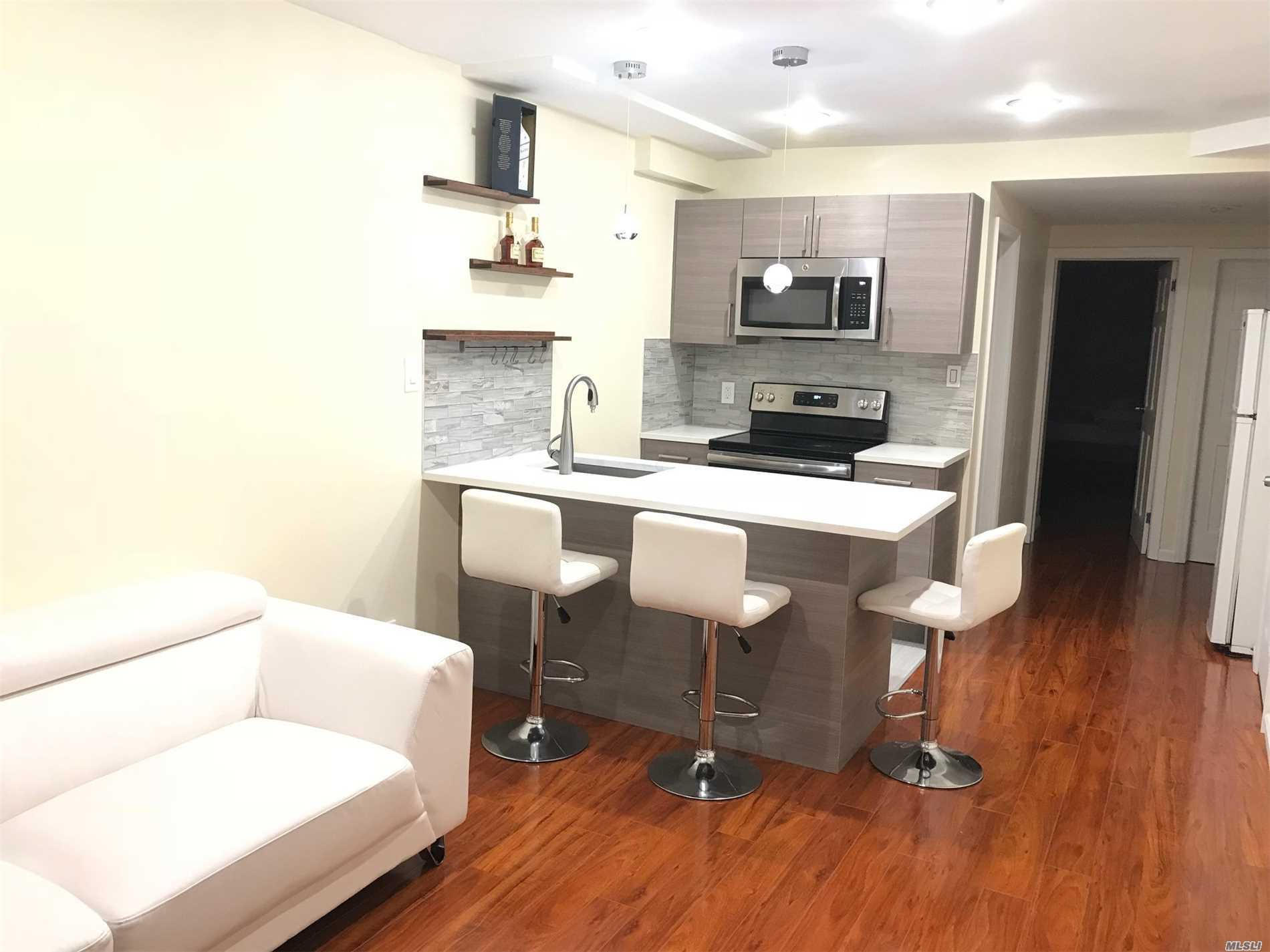 First Floor Unit In A Multiple Family Building. This Rental Unit Has Two Bedrooms, One Full Bath, New Open Style Kitchen With Living Room, And New Floors. There Is A Direct Access To Backyard. Only 2 Blocks From Subway Station #7 Train, 15 Min To Manhattan, Close Proximity To Supermarket, Park, Library, Laundry, And Highway.