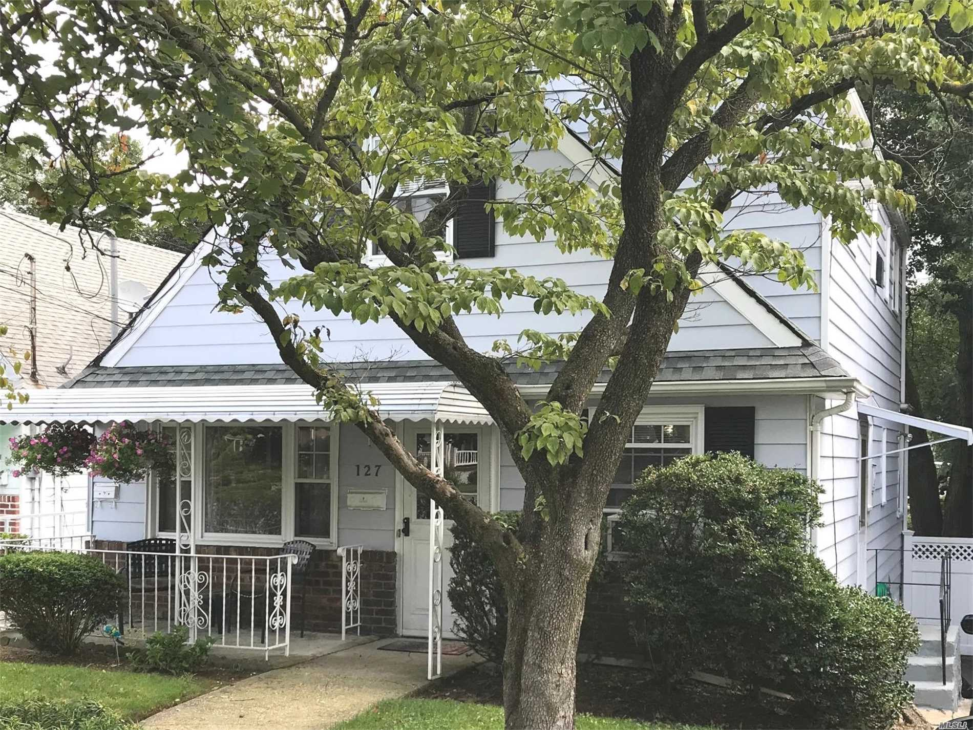 Legal Two Family On Quiet Block. Many Updates: Roof, Windows, Kitchen And Baths. Full Basement With Outside Entrance. Nice Size Property W/Private Multi-Car Driveway. Great Investment Opportunity!!